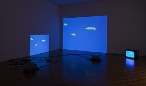 "Figure 15: Cory Arcangel ""Super Mario Clouds"" (2002). Video installation with modded game cartridge, dimensions variable."