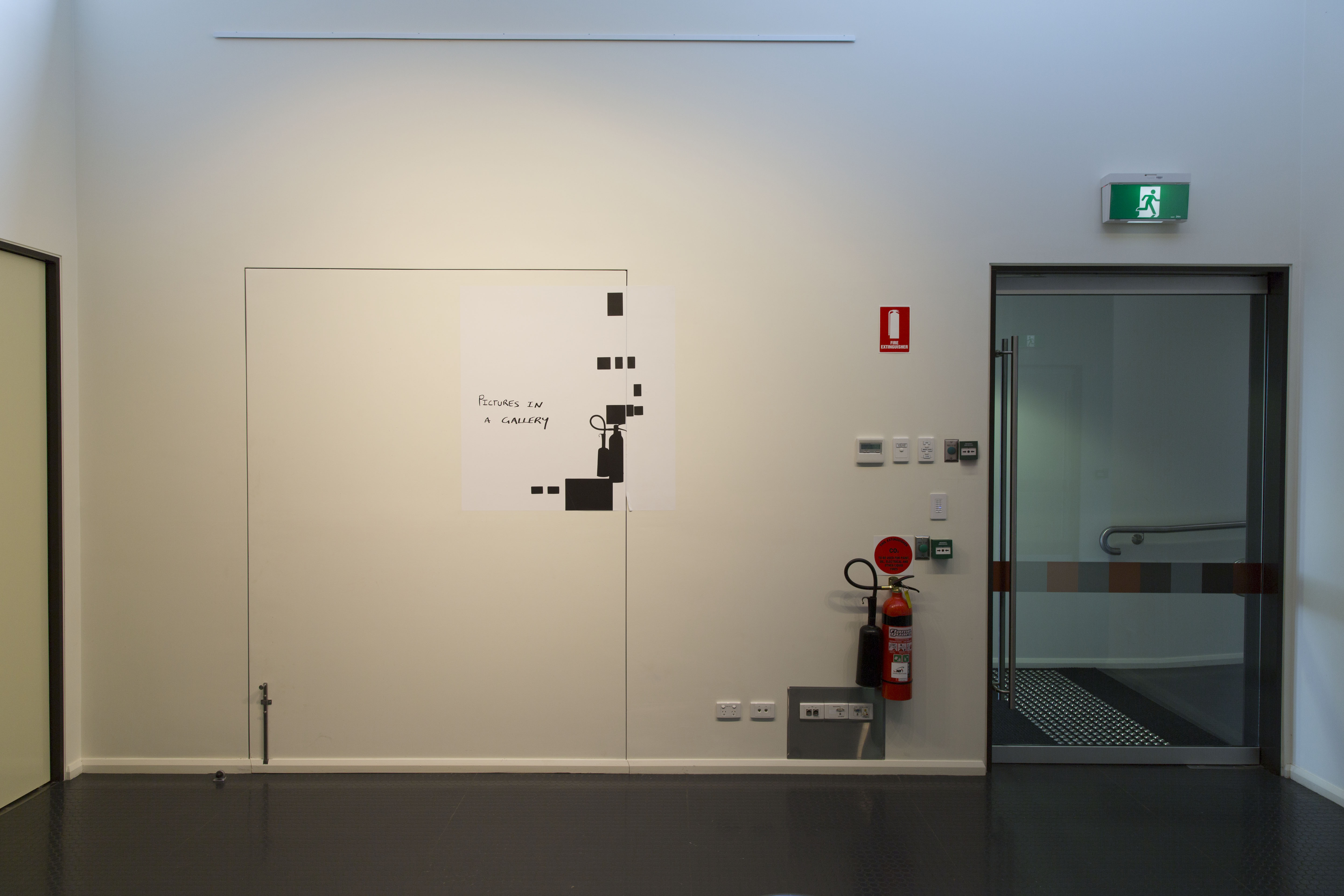 """Figure 26. Exhibition """"Picutres in a Gallery, curated by Jamie Holcombe 2013. Gallop Gallery, Charles Sturt University, Wagga Wagga. Digital photographs, hexachrome print on phototex"""
