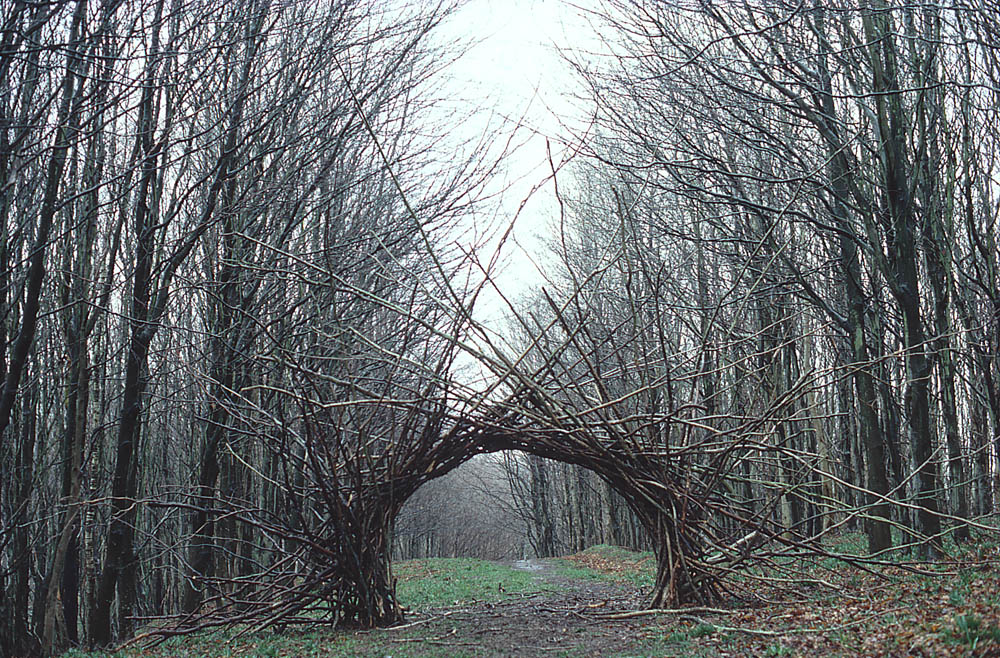 """Figure 30: Andy Goldsworthy """"Woven branch arch, Langholm, Dumfriesshire"""" 1986 site specific land art, digital archive. copyright Andy Goldsworth/ and the University of Glasgow."""