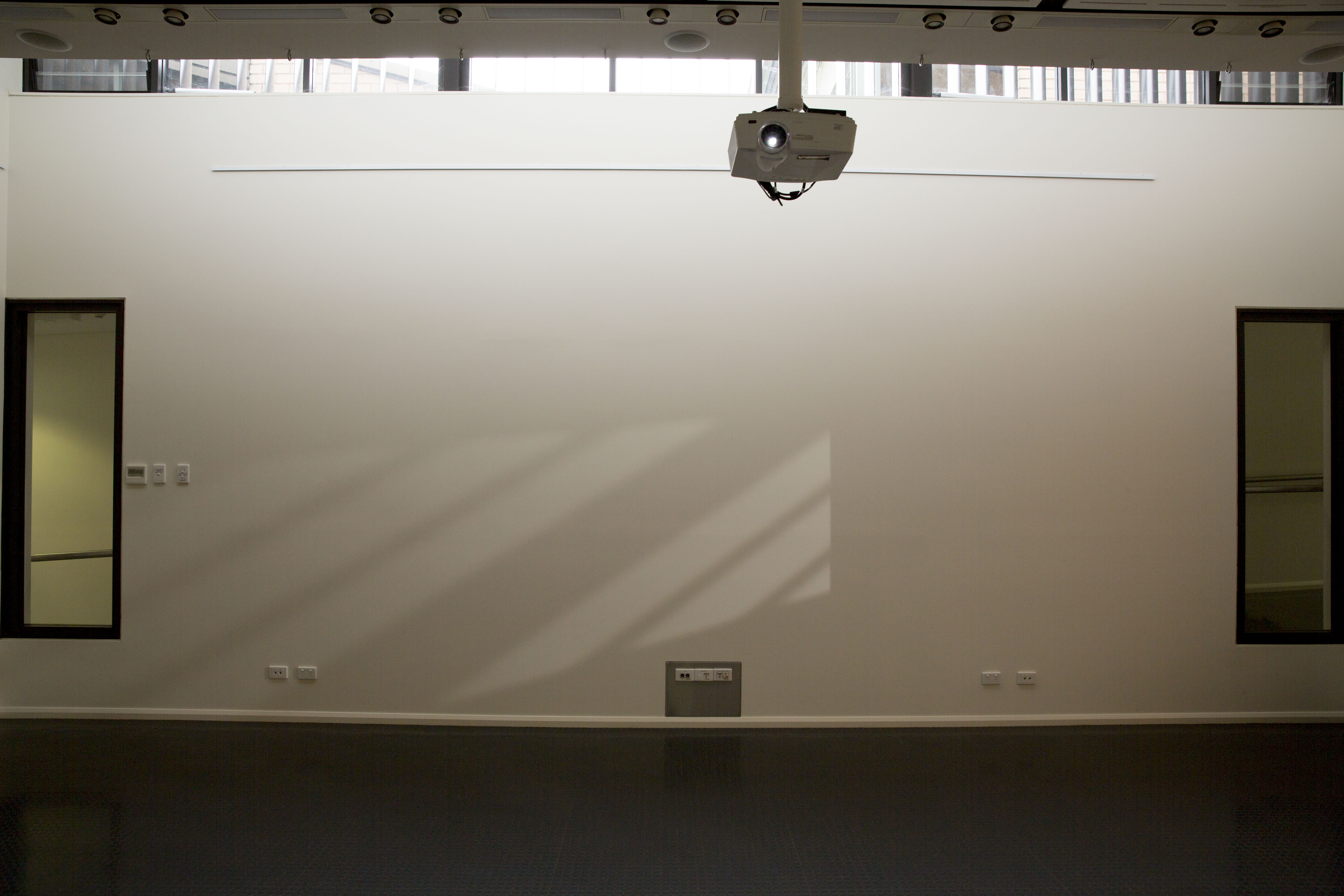 """Figure 7: """"Untitled"""" Digitally """"filmed"""" light, shadows and shutters as shadow-scape. Designed by Chris Orchard 2013 in the """"Pictures in a Gallery"""" exhibition, Gallop Gallery, CSU"""